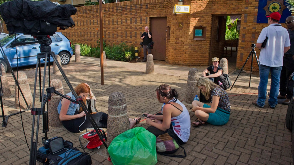 Journalists camp outside the police station in Brooklyn, east of Pretoria where athlete, Oscar Pistorius spent a fifth day in custody charged with the shooting death of his girlfriend Reeva Steenkamp on Monday, Feb. 18, 2013. (AP)