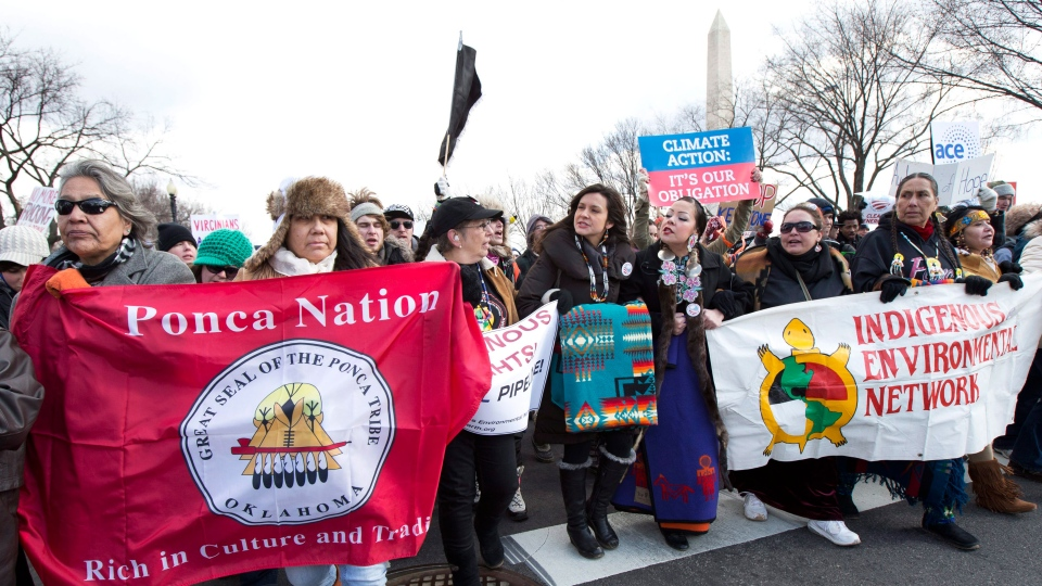 "Native Americans including Melina Laboucan, fifth from left, and Crystal Lameman sixth from, from the Cree Nation of Alberta, Canada, march with other protestors from the National Mall to the White House in Washington calling on President Barack Obama to reject the Keystone XL oil pipeline from Canada, as well as act to limit carbon pollution from power plants and ""move beyond"" coal and natural gas, Sunday, Feb. 17, 2013. (AP / Manuel Balce Ceneta)"