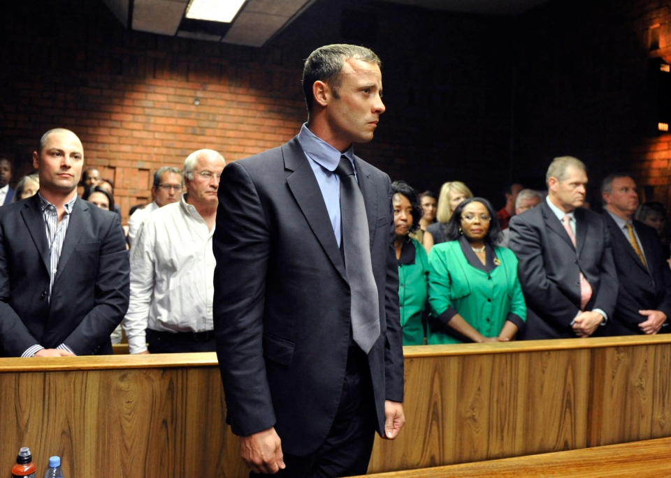 Oscar Pistorius stands following his bail hearing in Pretoria, South Africa, Tuesday, Feb. 19, 2013. (AP Photo)