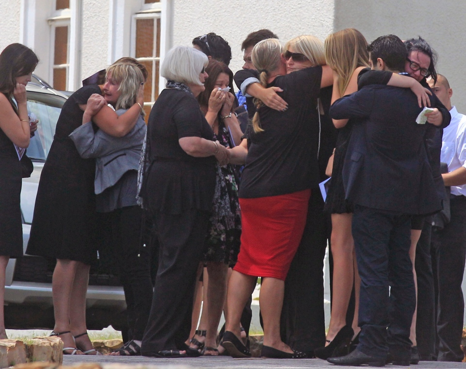 June Steenkamp, third left, the mother of Reeva Steenkamp, greets people after she and others attend her funeral, in Port Elizabeth, South Africa, Tuesday, Feb. 19, 2013. (AP / Schalk van Zuydam)