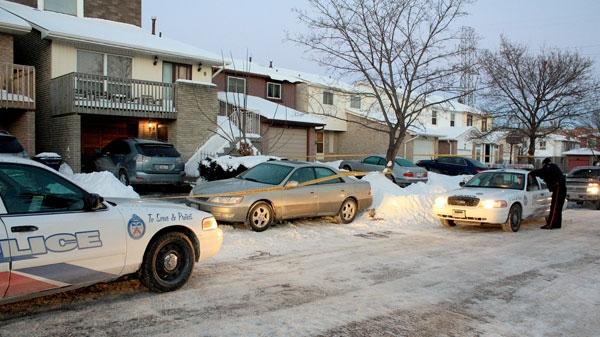 Toronto police investigate Kennaly Crescent, near McNicoll Avenue and Brimley Road, Monday, Jan. 17, 2011.(Tom Stefanac / CTV News)