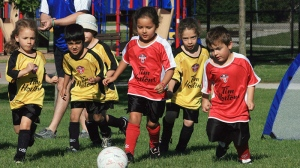 Children play in a soccer league in Oakville, Ont., on July 3, 2010. (Richard Buchan / THE CANADIAN PRESS)