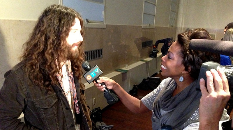 Ryan Gullen of The Sheepdogs speaks with CTV Toronto reporter Andria Case after 2013 Juno nominees were announced in Toronto, Tuesday, Feb. 19, 2013. (Jeff Long / CTV Toronto)