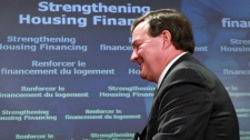 Finance Minister Jim Flaherty concludes a news conference on household debt, in Ottawa on Monday, Jan. 17, 2011. (Fred Chartrand / THE CANADIAN PRESS)