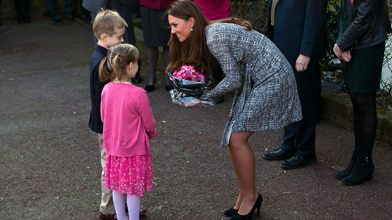 Kate, The Duchess of Cambridge receives flowers, as she leaves after a visit to Hope House, in London, Tuesday, Feb. 19, 2013. (AP / Matt Dunham)