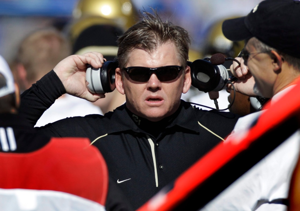 Colorado coach Dan Hawkins listens to an officials call on the sidelines during the first half of an NCAA college football game in this 2010 file photo. (AP Photo/Orlin Wagner)