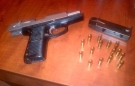 A handgun seized from a Huron Street home on Saturday, Feb. 16, 2013 is seen in this handout photo. (Courtesy London Police Service)
