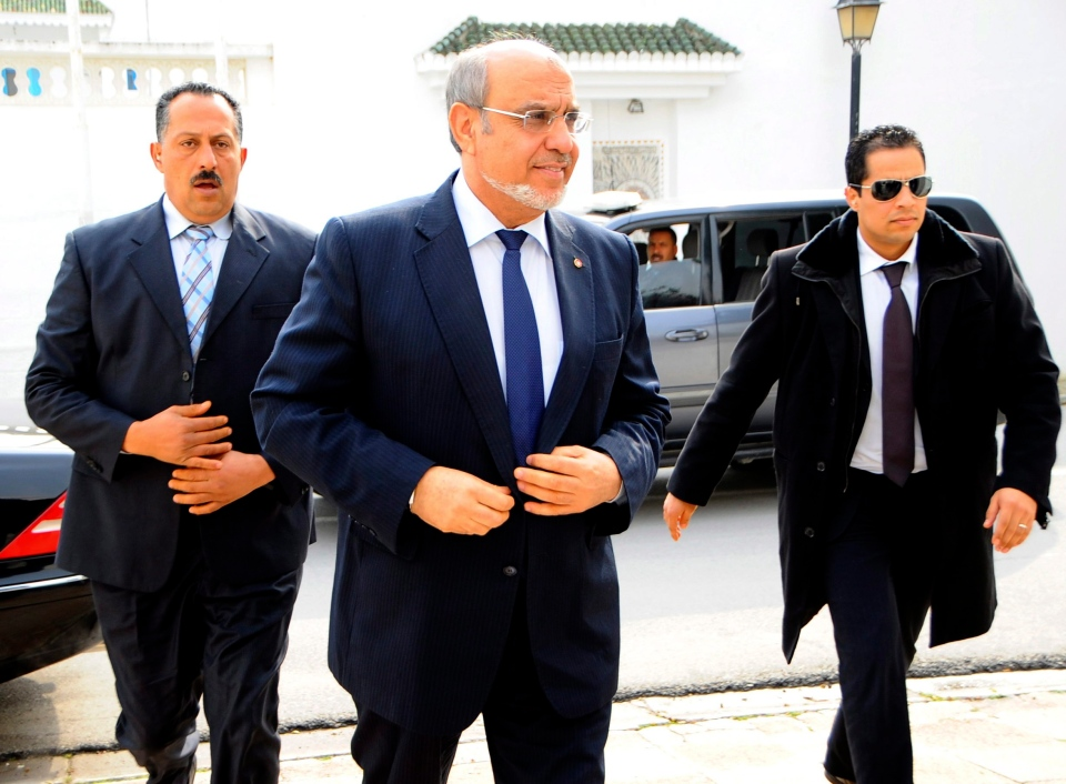 Tunisian Prime Minister Hamadi Jebali, center, arrives for meeting with political parties in an effort to end a crisis exacerbated by a political assassination two weeks ago, outside Tunis, on Feb. 18, 2013. (AP Photo/Hassene Dridi)