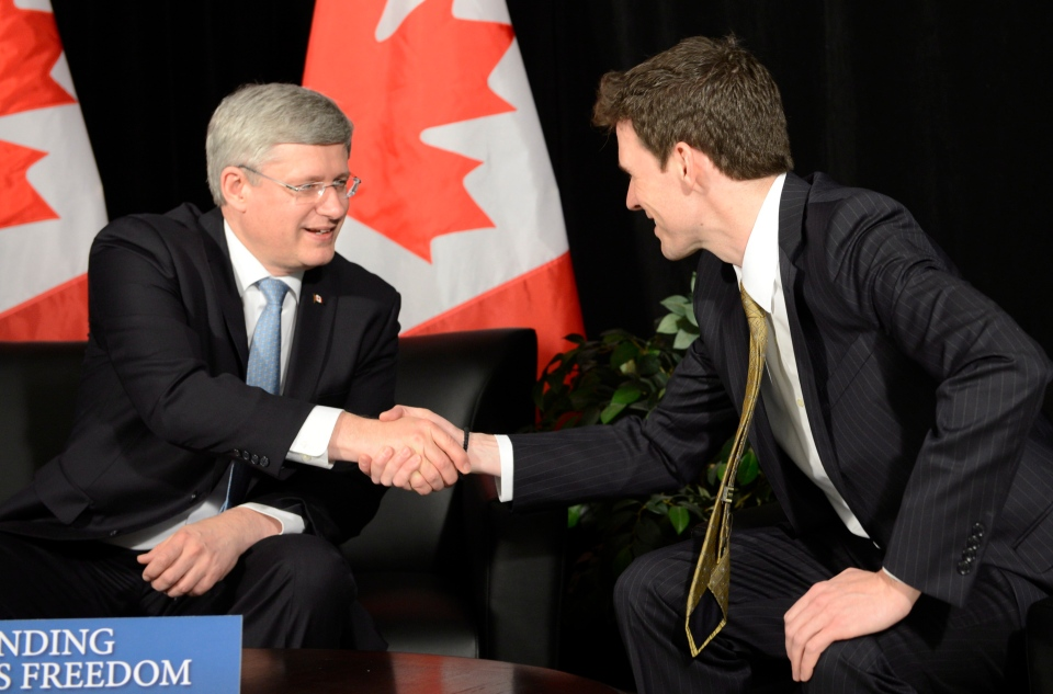 Prime Minister Stephen Harper shakes hands with Dr. Andrew Bennett as he is named ambassador to the Office of Religious Freedom, in Maple, Ont., north of Toronto, Tuesday, Feb. 19, 2013. (Frank Gunn / THE CANADIAN PRESS)