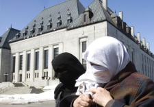 Maha Elsamnah (white niqab), mother of Omar Khadr, who is in Guantanimo Bay military prison, along with her daughter, in black, leave the Supreme Court of Canada in Ottawa on Wednesday, March 26, 2008. (Tom Hanson / THE CANADIAN PRESS)