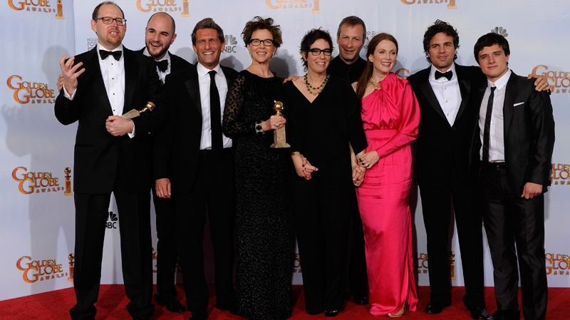 The cast and crew of 'The Kids Are All Right,' pose with the award they won for Best Motion Picture - Comedy Or Musical at the Golden Globe Awards Sunday, Jan. 16, 2011, in Beverly Hills, Calif. (AP / Matt J. Terrill)
