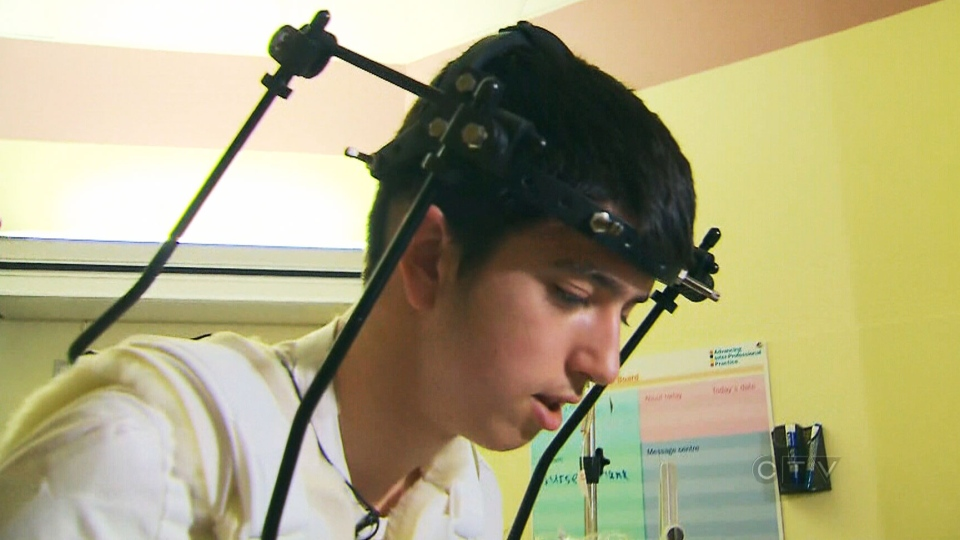 Justin Mendes, 16, had three bones in his neck snapped during a minor league hockey game after being checked from behind. Mendes is pictured in Sick Kids Hospital in Toronto, Feb. 19, 2013.