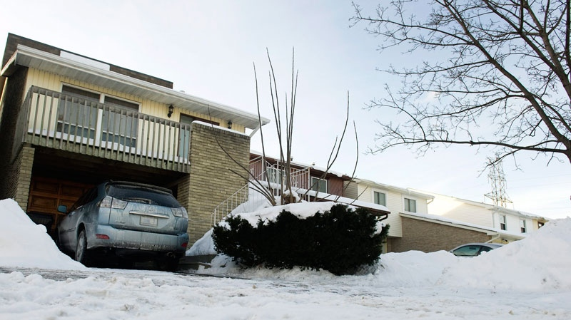 A car is parked in a driveway of a home where a 66-year-old woman froze to death early Monday morning in Toronto, Jan. 17, 2011. (Nathan Denette / THE CANADIAN PRESS)