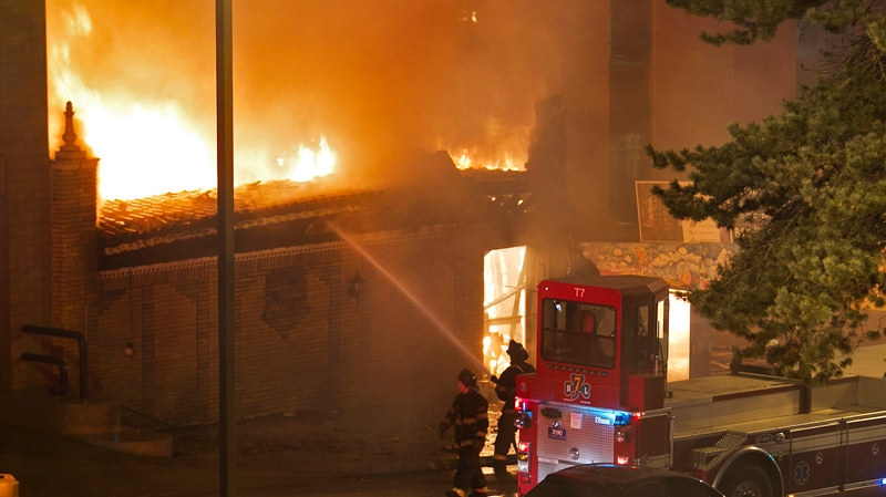 Firefighters are on the scene of a gas explosion and massive fire Tuesday night, Feb. 19, 2013 at JJ's restaurant at the Country Club Plaza in Kansas City, Mo. (AP Photo / The Kansas City Star, Tammy Ljungblad)