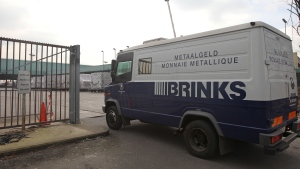 An armored truck of Brinks Diamond & Jewelry Services arrives at the cargo section of Brussels international airport, Tuesday, Feb. 19, 2013. (AP/Yves Logghe)