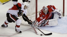 Ottawa Senators  center Chris Kelly tries to get the puck past Washington Capitals goalie Michal Neuvirth from The Czech Republic in the second period of an NHL hockey game in Washington Sunday, Jan. 16, 2011.(AP Photo/Alex Brandon)