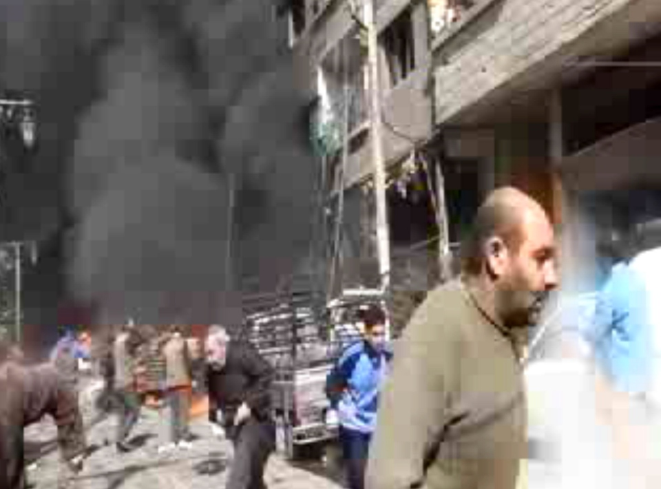 This image taken from video obtained from Ugarit News, which has been authenticated based on its contents and other AP reporting, shows smoke and fire after a fighter jet crashed into a suburb of Damascus, Syria on Feb. 20, 2013. (AP / Bambuser / SNN Hamouria)