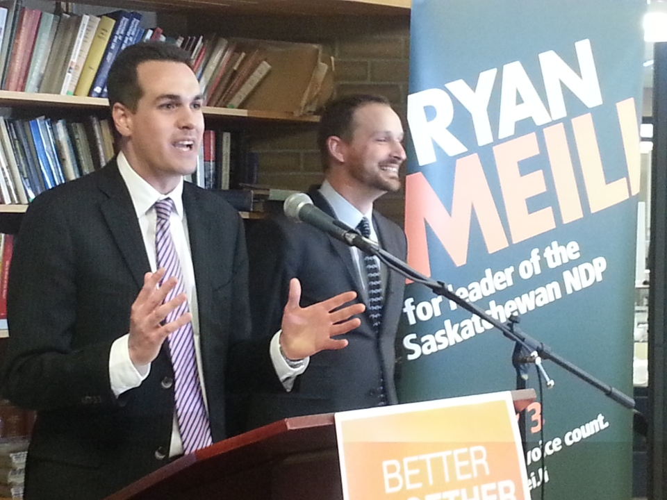 Erin Weir (left) announces he's dropping out of the Saskatchewan NDP leadership race and throwing his support behind Ryan Meili (right) at a news conference Wednesday in Regina.