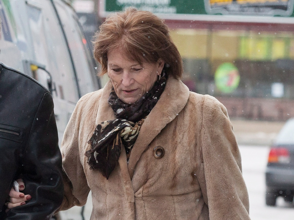 Ashley Smith's mother Coralee Smith walks into Coroners Courts in Toronto to testify regarding her adopted daughter's treatment and death in federal prison in Toronto on Feb., 20, 2013. (Michelle Siu/THE CANADIAN PRESS)
