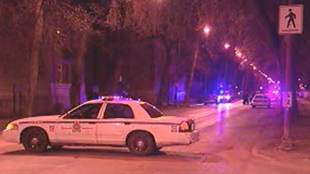 Winnipeg police investigate a fatal shooting on Maryland Street in April 2012.