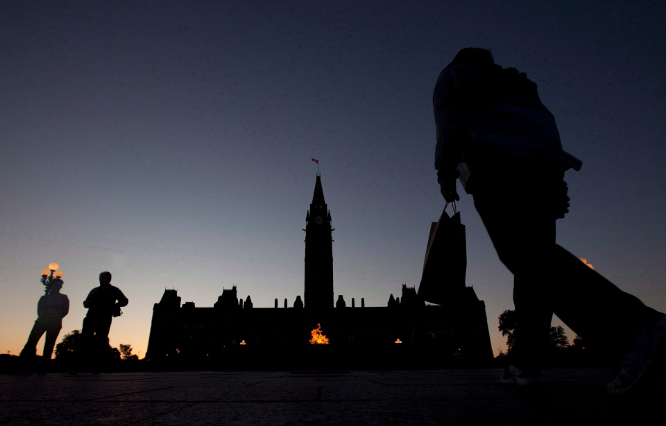 The Parliament buildings are silhouetted at dusk in Ottawa, Wednesday June 13, 2012. (THE CANADIAN PRESS/Adrian Wyld)