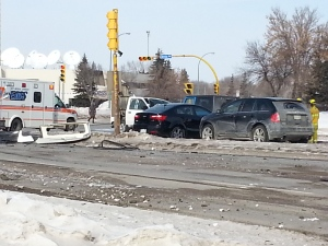 Emergency crews respond to a fatal crash involving several vehicles at the intersection of Arcola Avenue and Park Street in Regina on Wednesday.