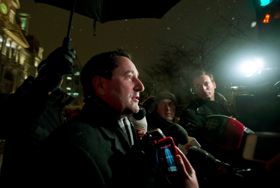 Montreal Mayor Michael Applebaum speaks to reporters outside City Hall in Montreal following a raid by UPAC on the premises on Feb. 19, 2013. (Graham Hughes / THE CANADIAN PRESS)