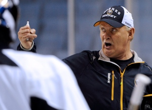 Buffalo Sabres head coach Lindy Ruff gives instructions during the first day of the team's NHL hockey training camp in Buffalo, N.Y. in this January 2013 file photo. (AP Photo/Gary Wiepert)