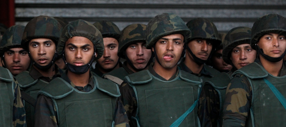 Egyptian army soldiers stand guard during a demonstration in front of the presidential palace in Cairo, Egypt on Tuesday, Dec. 11, 2012. (AP / Petr David Josek)