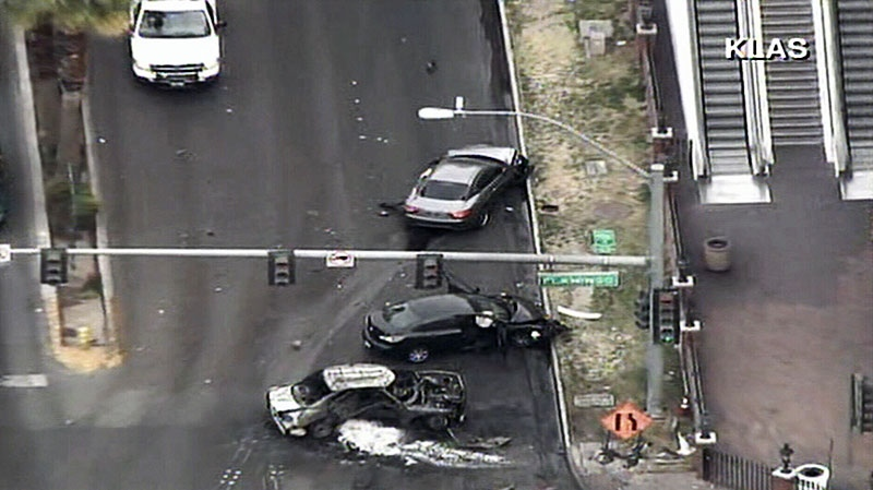 In this image captured from video, the aftermath of a reported 'gun battle' is seen on Las Vegas Strip, Thursday, Feb. 21, 2013. (KLAS-TV Channel 8 News Now)