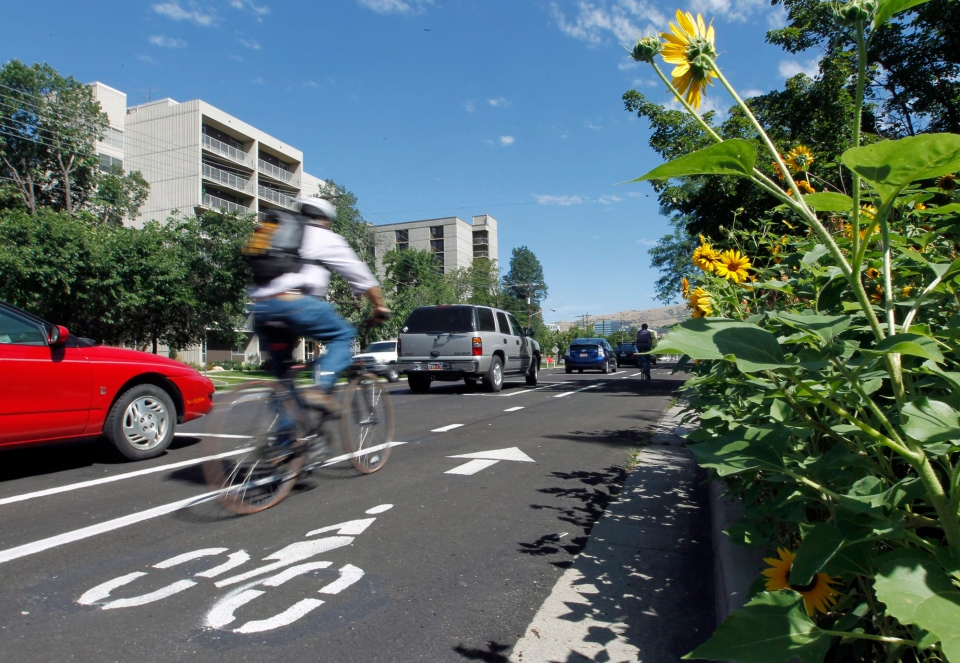 A bicyclist rides along Salt Lake City's separated bikeway in this June 2012 file photo. (AP Photo/Al Hartmann/The Salt Lake Tribune)