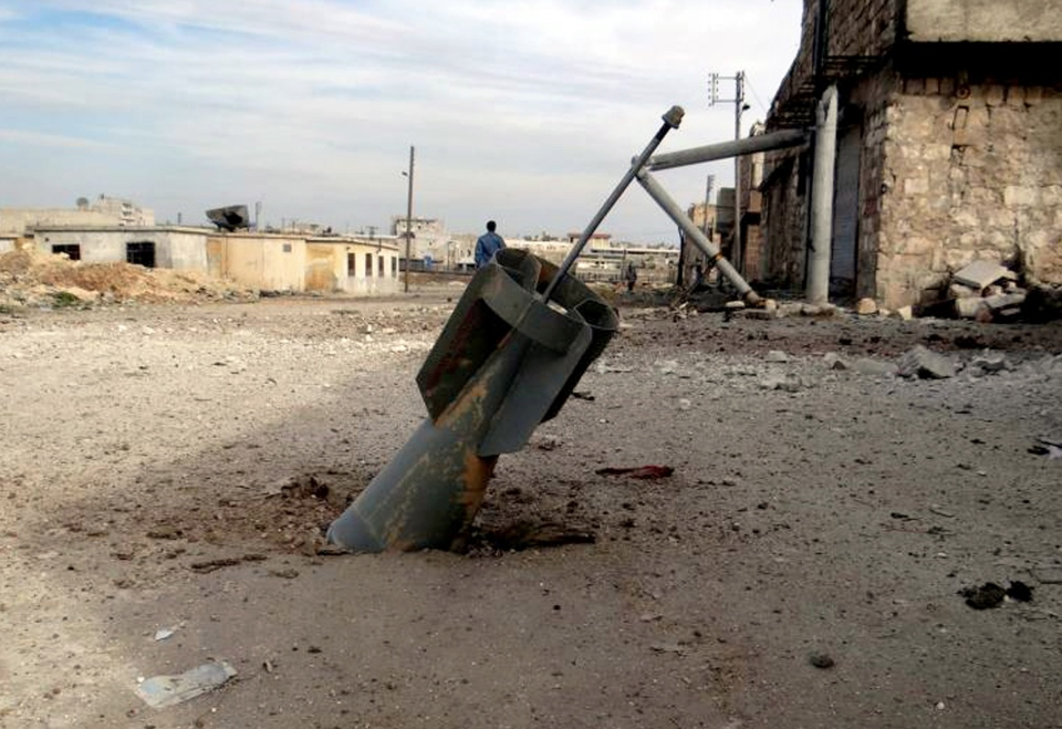 An unexploded rocket from a Syrian warplane is shown in the neighbourhood of Karam Alqasir, near Aleppo International Airport, in Aleppo, Syria, Thursday, Feb. 21, 2013. (Aleppo Media Center AMC)