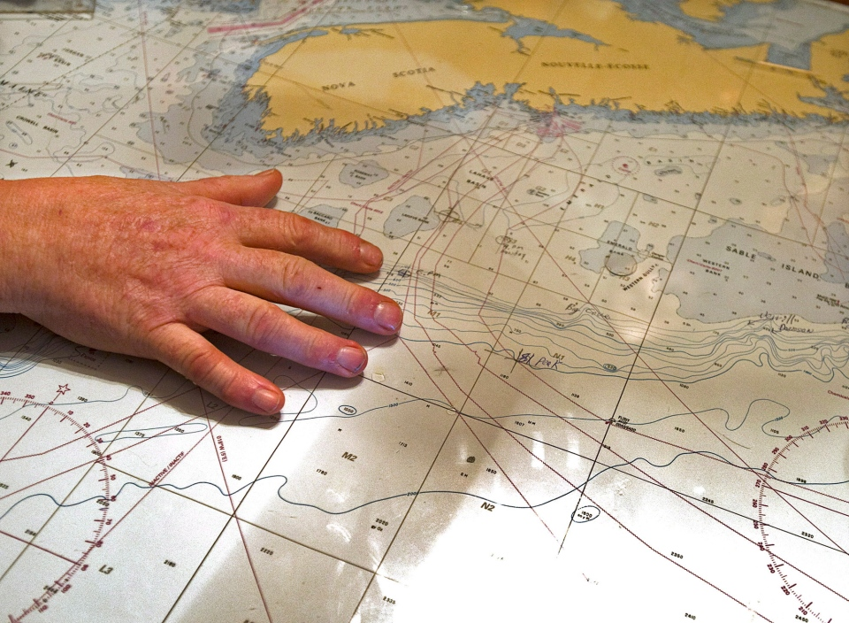 George Hopkins displays a map as talks about the decision to call off the search for the crew of the missing fishing boat Miss Ally in Woods Harbour, N.S. on Feb. 20, 2013. (Andrew Vaughan / THE CANADIAN PRESS)