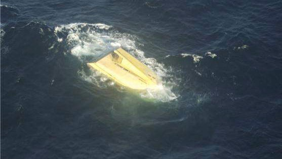 The capsized fishing boat Miss Ally is shown in a Canadian Forces handout photo. The pressure is mounting on Ottawa to retrieve a capsized fishing vessel off southwest Nova Scotia that may contain the bodies of five missing fishermen. (HO-Canadian Forces / THE CANADIAN PRESS)