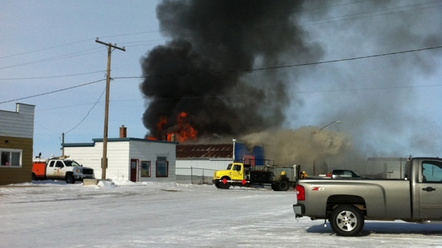 Merchandise on Main in Lafleche burns as firefighters work to extinguish the flames Wednesday. (Betty-Ann Tallon)