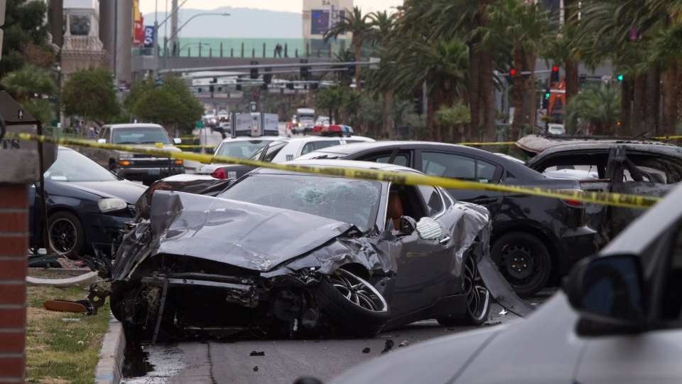 Police rope off the scene of a shooting and multi-car accident on the Las Vegas Strip in Las Vegas early Thursday, Feb. 21, 2013. (AP / Las Vegas Sun, Steve Marcus)