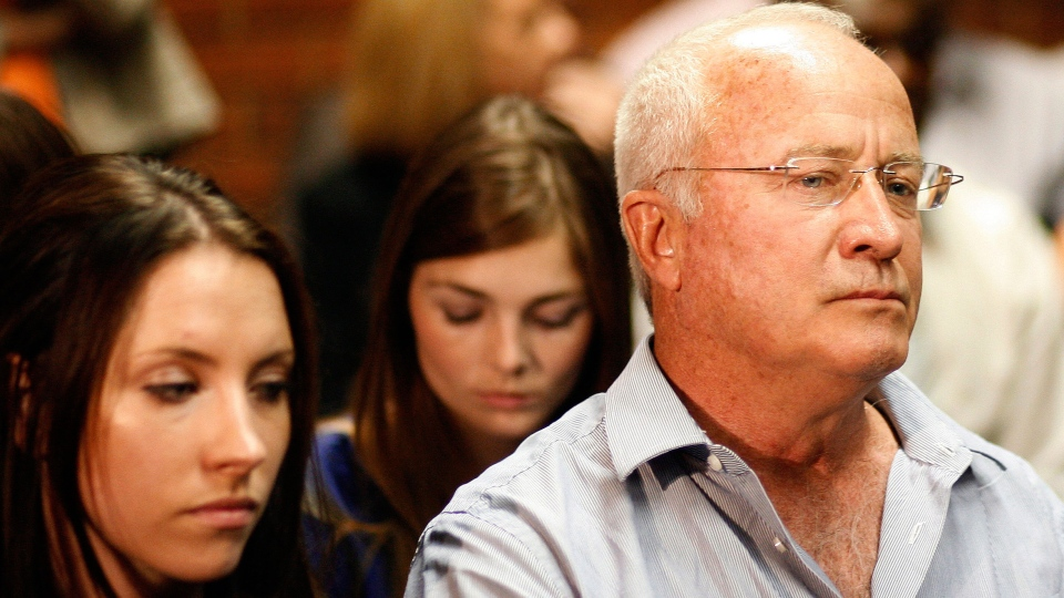 Olympic athlete Oscar Pistorius's father Henke Pistorius, right, with daughter Aimee, left, during his bail hearing at the magistrate court in Pretoria, South Africa, Thursday, Feb. 21, 2013. (AP / Themba Hadebe)
