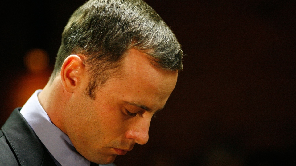 Olympic athlete Oscar Pistorius stands during his bail hearing at the magistrate court in Pretoria, South Africa, Thursday, Feb. 21, 2013. (AP / Themba Hadebe)