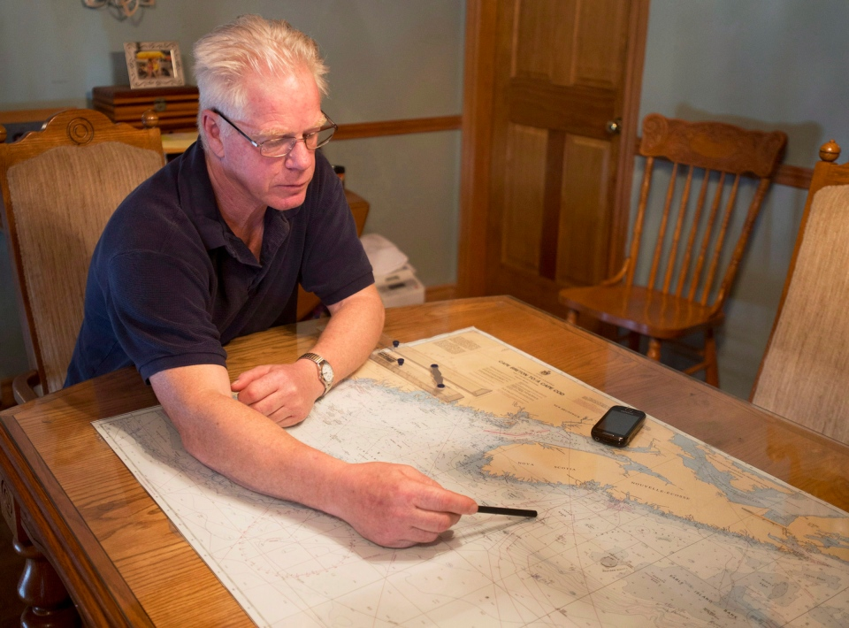 George Hopkins displays a map as talks about the decision to call off the search for the crew of the missing fishing boat Miss Ally in Woods Harbour, N.S. on Wednesday, Feb. 20, 2013. (Andrew Vaughan  / THE CANADIAN PRESS)