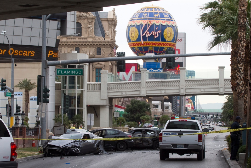 Police rope off the scene of a shooting and multi-car accident on the Las Vegas Strip in Las Vegas early Thursday, Feb. 21, 2013. (Las Vegas Sun /, Steve Marcus)