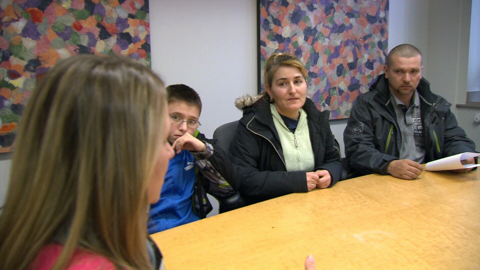 Lawyer Chantal Desloges meets with a family from Hungary in her Toronto office on Thursday, Feb. 21, 2013.