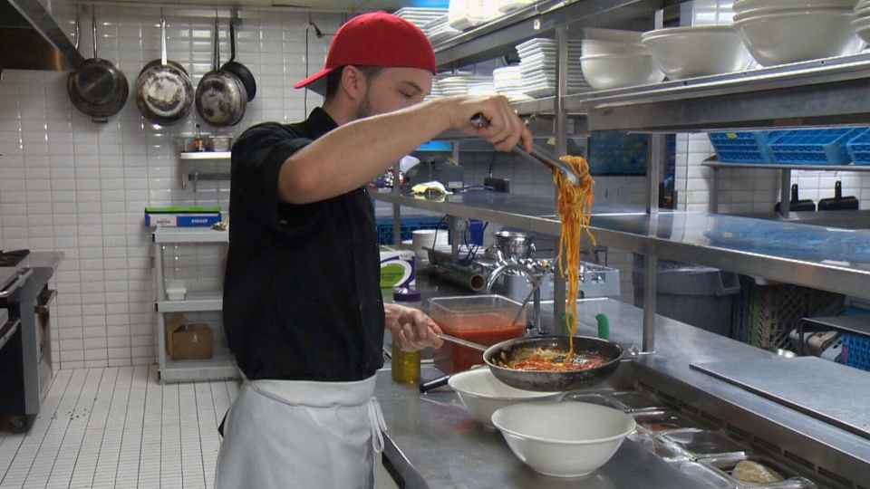 A chef prepares pasta in an Italian restaurant in Montreal on Thursday, Feb. 21, 2013.