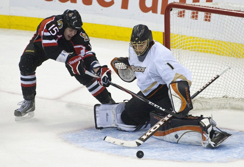 Ottawa Senators' Zack Smith loses control of the puck as he tries to put it past Anaheim Ducks goaltender Jonas Hiller during the second period of an NHL hockey game in Ottawa on Tuesday, Jan. 18, 2011. (AP Photo/The Canadian Press, Pawel Dwulit)