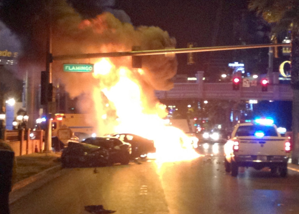 Smoke and flames billow from a burning vehicle following a shooting and multi-car accident on the Las Vegas Strip in Las Vegas early Thursday, Feb. 21, 2013. (AP / Erik Lackey)