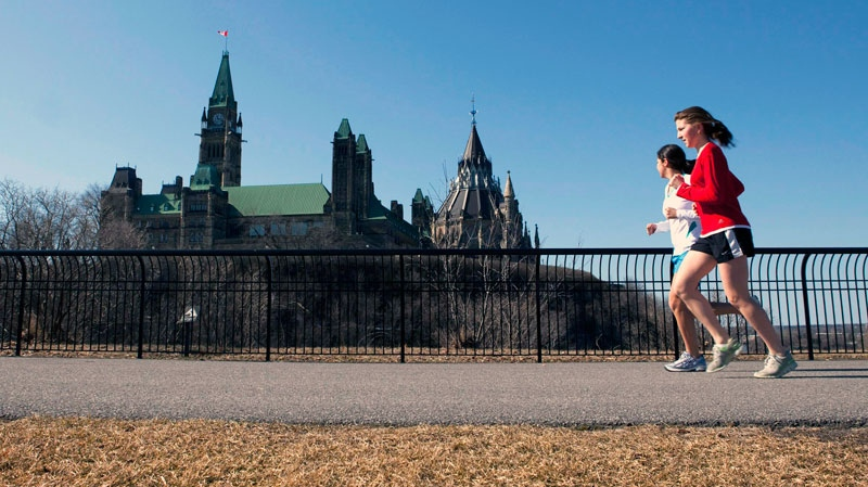 Joggers make their way through Majors Hill Park in downtown Ottawa in view of Parliament Hill on Wednesday, March 17, 2010. (Sean Kilpatrick / THE CANADIAN PRESS)