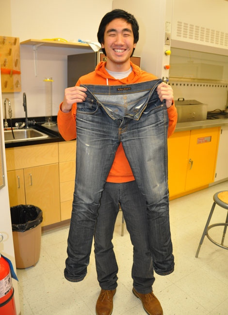Josh Le shows off the jeans he didn't wash for 15 months. (University of Alberta)