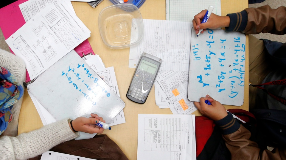 Students solve math problems at a California high school in this January 2013 file photo. (AP / Jae C. Hong)