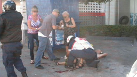 Emergency workers in Mazatlan, Mexico tend to B.C. resident Mike Di Lorenzo, who was shot in the leg during a gangland execution while he was vacationing in Mexico, Monday, Jan. 17, 2011.