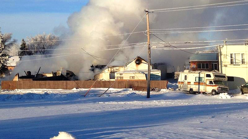 Smoke continued to billow from what was left behind after a fire tore through the Pioneer Hotel in Sedgewick overnight. Courtesy: Connie Mikkelson Cote.