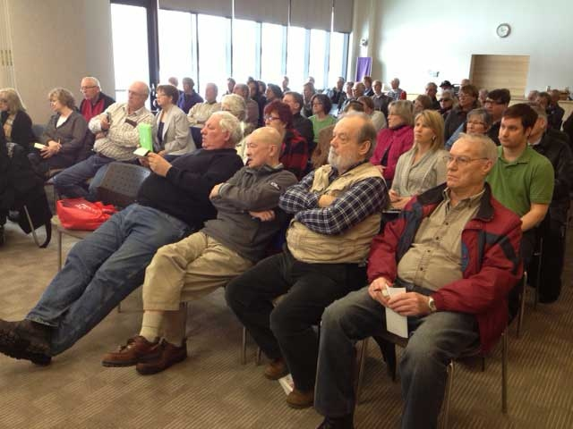 A crowd looks on as a report on wind turbines is presented by the Grey Bruce Health Unit in Owen Sound, Ont. on Friday, Feb. 22, 2013. (Scott Miller / CTV London)